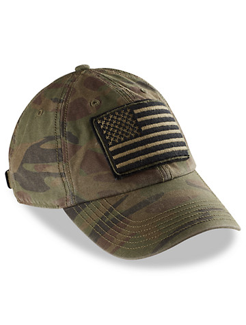 """You cant camouflage patriotism. Wherever you are, youre the one cheering your country the loudest, and through it all, this paneled cap matches your fervor with its bold, camo-patterned combination and American flag patch on the front. 100% stonewashed cotton twill camouflage print added to bill and backraised embroidered American flag on front six-panel design features a pre-curved bill self-fabric back fits up to 25 1/4"""" circumferenceOperation Hat Trick generates awareness and support for the recovery of wounded service members and veterans through the sale of OHT branded merchandise and donates to those organizations that fulfill OHT's mission. Founded at the University of New Hampshire, OHT is dedicated to Nate Hardy and Mike Koch, two Navy SEALS who were killed in Iraq in 2008. Through a partnership with '47 Brand, participating Collegiate Institutions, pro Minor League teams, Leagues, Retailers, and Corporations, OHT is able to help those recovering from unthinkable injuries spo"""